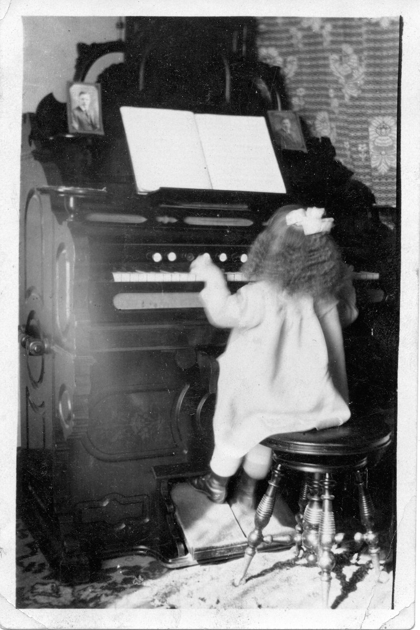 Someone's child playing the organ.